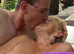 Big-busted granny doggystyled by young cock