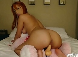 redhead gets fucked by a teddy obey with strap on